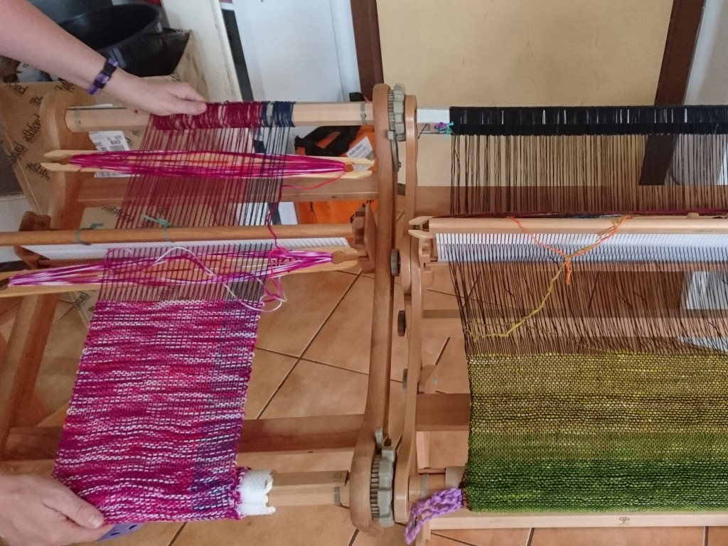 Two looms being held side-by-side
